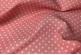Розовая ткань в светлый горошек